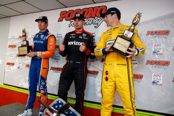 Will Power, center, poses after winning the IndyCar Series auto race at Pocono Raceway with second place finisher Scott Dixon, left, and third place finisher Simon Pagenaud, Sunday in Long Pond, Pa.