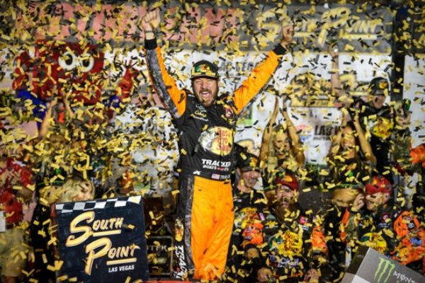 Martin Truex Jr. celebrates in victory lane after winning the South Point Hotel & Casino 400 at Las Vegas Motor Speedway.