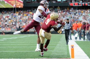 Boston College wide receiver Kobay White catches a touchdown pass while Virginia Tech defensive back Jermaine Waller defends.
