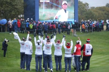 Members of Team USA celebrate on the 18th green as they watch Danielle Kang win 2&1 against Europe during the afternoon Fourballs.